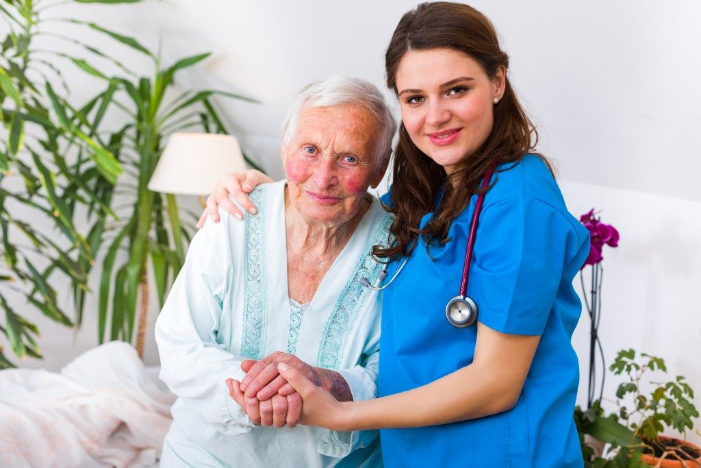 caregiver with en elderly patient