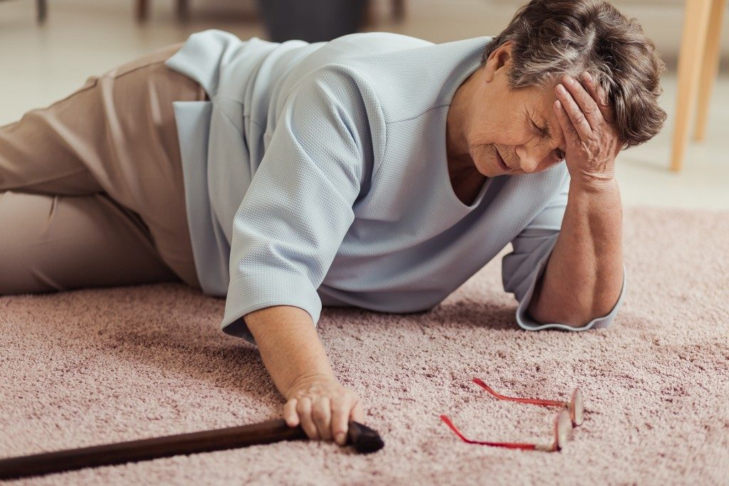 Elderly woman lying on the floor