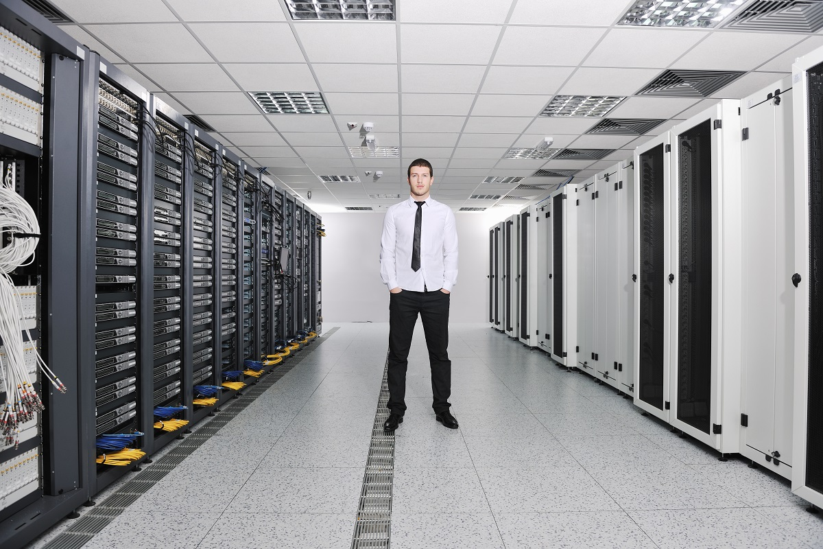 Employee standing in the middle of the server room