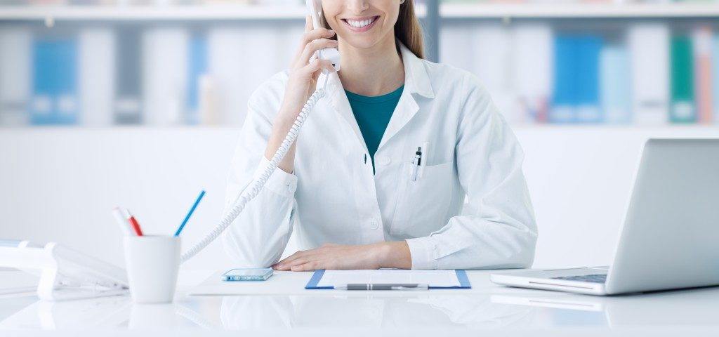 Doctor smiling at her desk