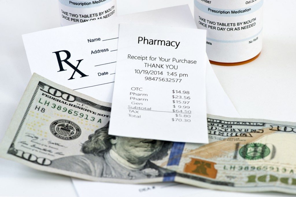 Pharmacy receipt with prescription bottle