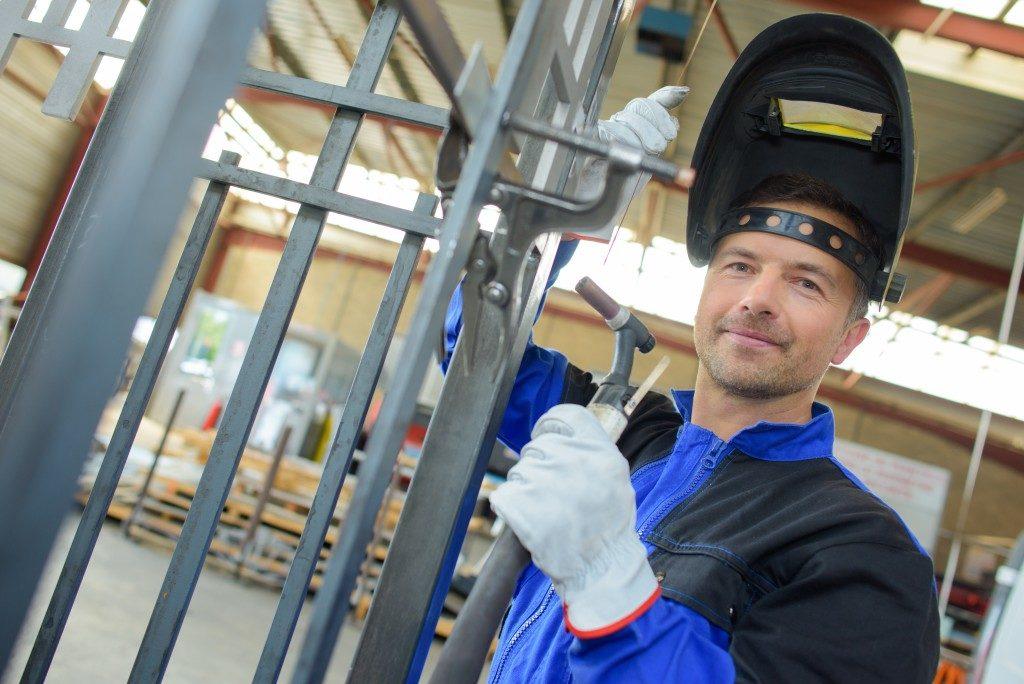 welder holding a tool