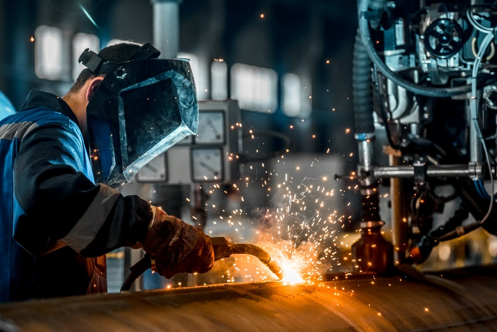 welder wearing protection mask while working