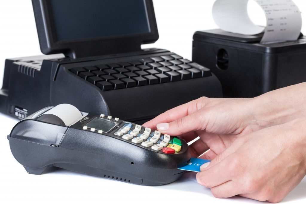 person inserting a card in the POS system