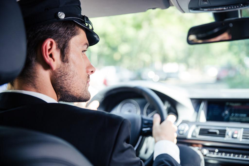 chauffeur riding car