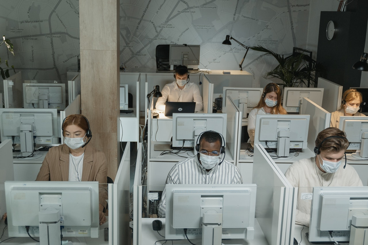 employees working wearing facemasks